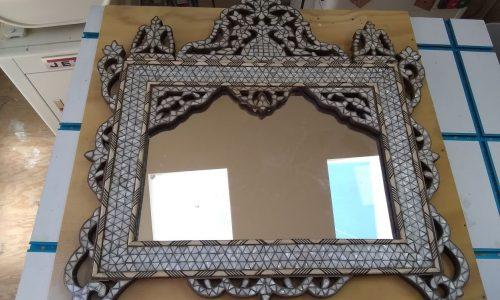 Repaired mirror corner